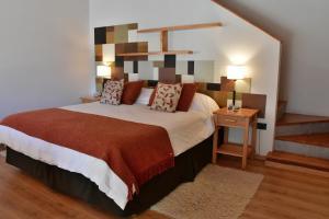 Una cama o camas en una habitación de Amarras