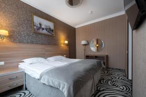 Кровать или кровати в номере Отель Матисов Домик у Новой Голландии