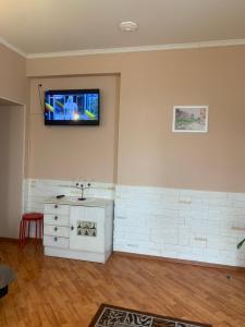 Телевизор и/или развлекательный центр в Vereyskaya 54 Appartement