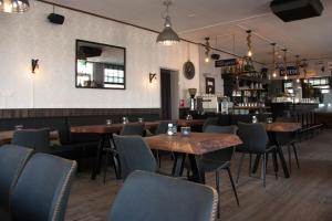 A restaurant or other place to eat at Eetcafe Pension 't Overleg