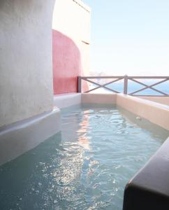 The swimming pool at or near Bubble Suite Santorini