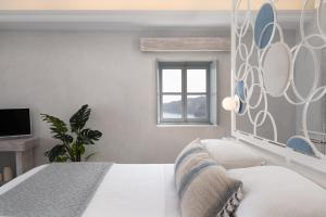 A bed or beds in a room at Bubble Suite Santorini