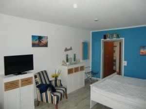 TV/Unterhaltungsangebot in der Unterkunft Haus am See Beach App. am Kranichsee