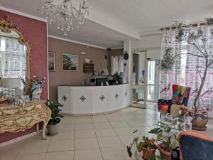 The lobby or reception area at Il Mirto E La Rosa