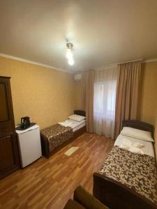 Кровать или кровати в номере Guest House Liana
