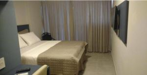 A bed or beds in a room at Hotel do Mar Cabo Branco