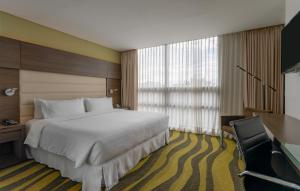 A bed or beds in a room at Four Points By Sheraton Bogota