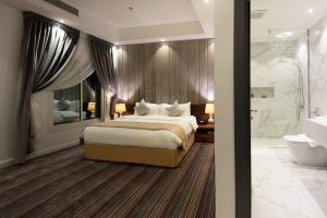 Cama ou camas em um quarto em Beach Time Villas Hotel - Family Villas