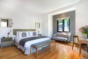 Cama o camas de una habitación en The Aubrey Boutique Hotel