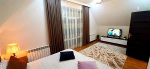 Cama ou camas em um quarto em Dom Semya