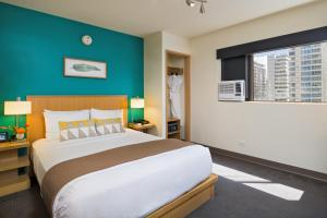 A bed or beds in a room at VIVE Hotel Waikiki