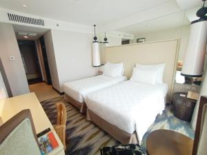 A bed or beds in a room at Swiss-Belresidences Kalibata