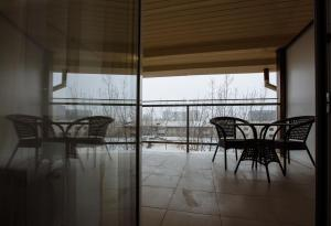 A balcony or terrace at Hotel Kazzhol Almaty