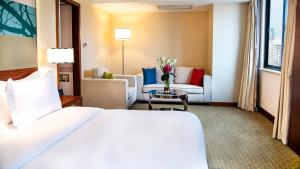 Ein Bett oder Betten in einem Zimmer der Unterkunft Holiday Inn Shenzhen Donghua, an IHG Hotel