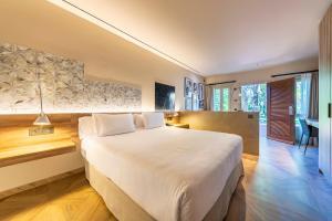 Cama o camas de una habitación en Huerto del Cura