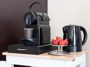 Kaffee-/Teezubehör in der Unterkunft Galerie Hotel