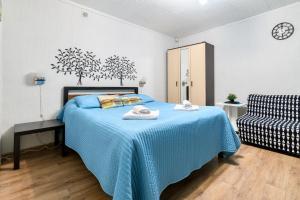 Кровать или кровати в номере Апартаменты у Медного всадника