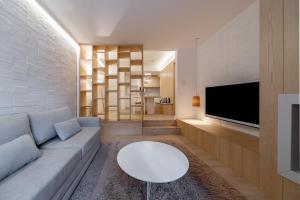Uma área de estar em Flat Prodigy Serrano Hotel