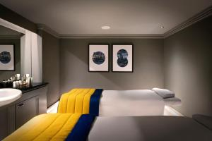 A bed or beds in a room at Leonardo Royal London City - Tower Hill