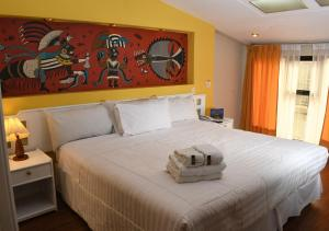 A bed or beds in a room at Hotel Qalasaya by Prima Collection