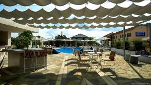 The swimming pool at or near Seaside Suites