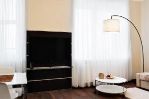 Телевизор и/или развлекательный центр в Апартаменты возле Крокус Экспо