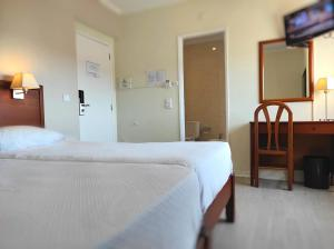A bed or beds in a room at Hotel Sao Mamede