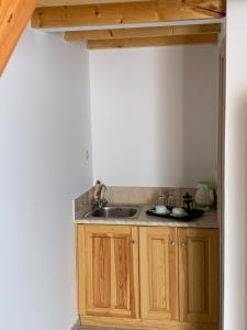 Η κουζίνα ή μικρή κουζίνα στο Glaros Guesthouse