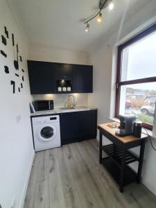 A kitchen or kitchenette at Central Portree Apartment