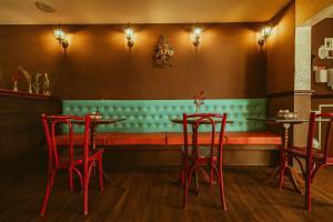 Um restaurante ou outro lugar para comer em Vivaz Boutique Hotel