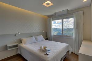 Cama ou camas em um quarto em Pousada Janela do Vale
