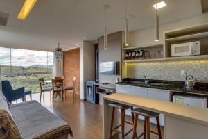 A cozinha ou cozinha compacta de Pousada Janela do Vale