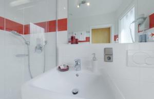 Ein Badezimmer in der Unterkunft Hotel Restaurant Thum