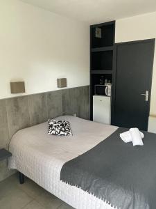 Un ou plusieurs lits dans un hébergement de l'établissement Le Clos la Verdière