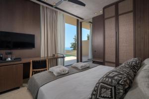 En eller flere senger på et rom på Porto Angeli