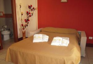 Letto o letti in una camera di Villa Barone