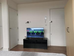 A television and/or entertainment center at Modern studio in the heart of Maidstone