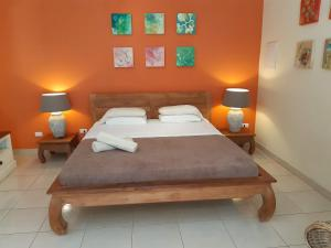 A bed or beds in a room at Wonders Boutique Hotel