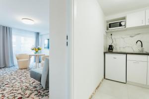 A kitchen or kitchenette at Apartamenty i Domki Górski Potok