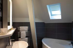 Salle de bains dans l'établissement Hôtel et Spa La Villa K - Basel Airport