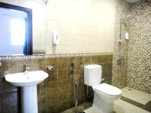 A bathroom at Al Badaa Star Residence
