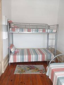 Uma ou mais camas em beliche num quarto em Cubiculum Gaya