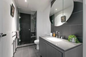 A bathroom at Complete Host Wrap Apartments