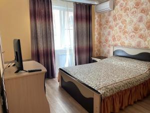 Кровать или кровати в номере Apartment Lenina 10