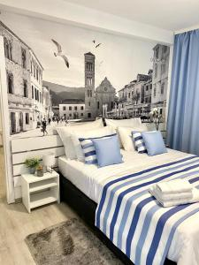 A bed or beds in a room at Family Resort Urania