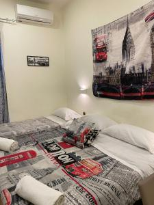 A bed or beds in a room at Hotel Alessandro Poerio