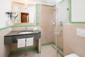 Ein Badezimmer in der Unterkunft Hotel Gasthaus Kreuz Post