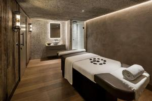 A bathroom at The Edwardian Manchester, A Radisson Collection Hotel
