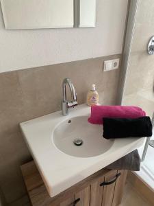 Ein Badezimmer in der Unterkunft Ferienwohnungen Jakobsberg