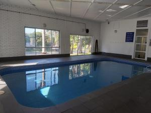 The swimming pool at or near Eden Motel